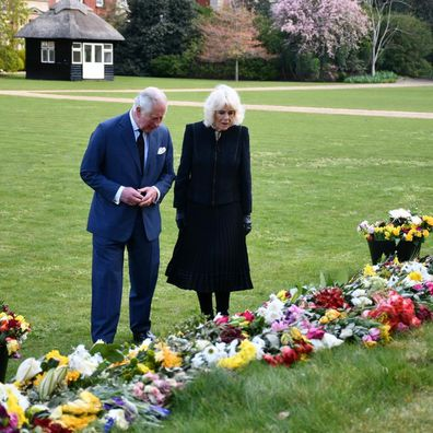 Prince Charles and Camilla, Duchess of Cornwall view floral tributes left for Prince Philip at Marlborough House Gardens