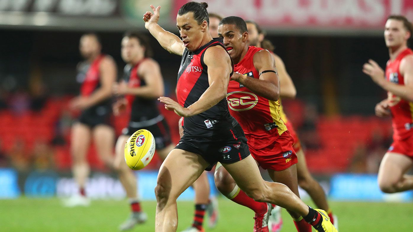 : Dylan Shiel of the Bombers kicks during the round 11 AFL match between the Gold Coast Suns and the Essendon Bombers at Metricon Stadium on August 12, 2020 in Gold Coast, Australia. (Photo by Chris Hyde/Getty Images)