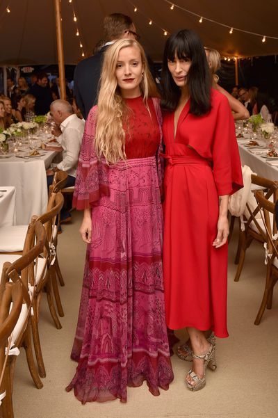 Kate Foley and Athena Calderone at the Net-a-porter x GOOD+ dinner at the Seinfeld's estate.