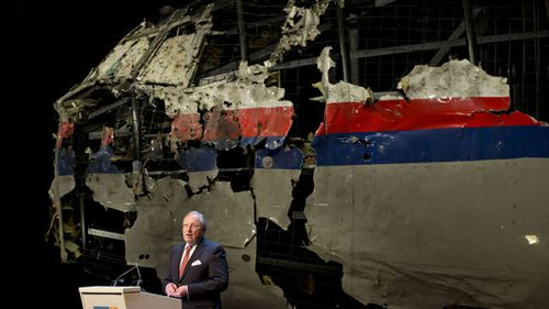The rebuilt fuselage of Malaysia Airlines flight MH17 during a press conference to present the report findings of the Dutch Safety Board in Gilze Rijen. (AAP)