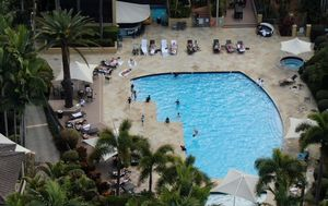 Anger grows at Queensland border rules as AFL officials enjoy lockdown luxury at resort
