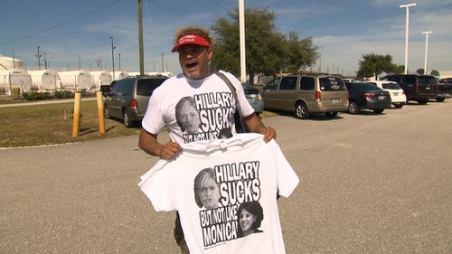 A Trump supporter selling some questionable t-shirts. (Laura Turner/9NEWS)