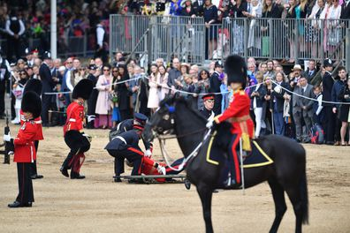soldier falls off horse at trooping the colour
