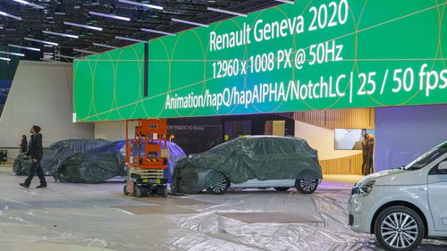 Cars are pictured as workers stop the preparation of the 90th Geneva International Motor Show, GIMS, at Palexpo, in Geneva, Switzerland, Friday, Feb. 28, 2020
