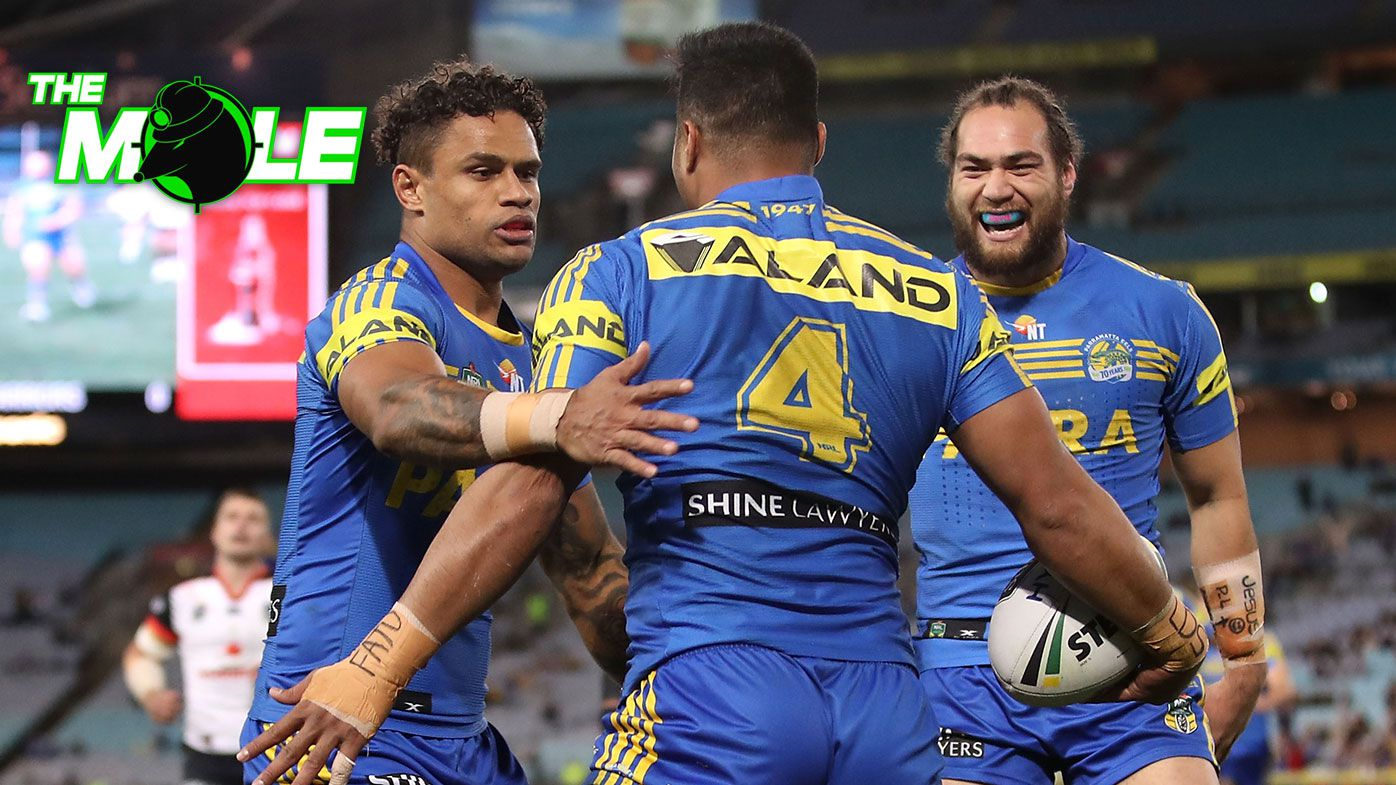 Kirisome Auva'a is embraced by Parramatta Eels teammates.