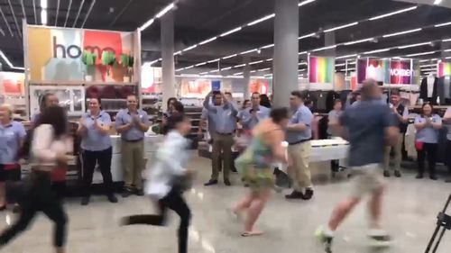 Crowds run into new Kmart store at Coffs Harbour this morning. (9NEWS)