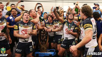 The team celebrated together after the game with cheers and a few toasts. (AAP)