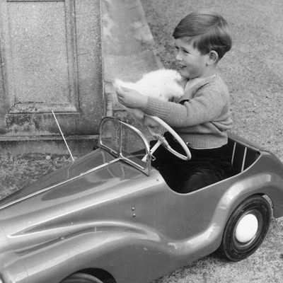 1952: Prince Charles plays in a miniature car in the grounds of Balmoral Castle.