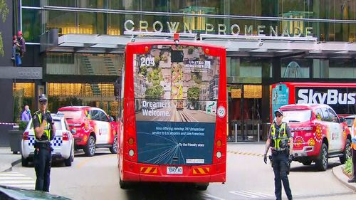 A bus of new arrivals into Australia are ferried into the Crown Promenade in Melbourne.
