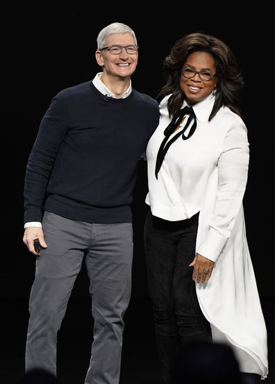 Apple CEO Tim Cook and Oprah Winfrey.