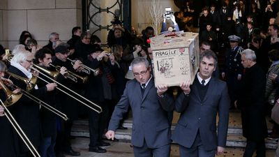 The coffin containing Bernard Verlhac, aka Tignous, the late French caricaturist of satirical newspaper Charlie Hebdo, leaves the city hall of Montreuil. (AP)