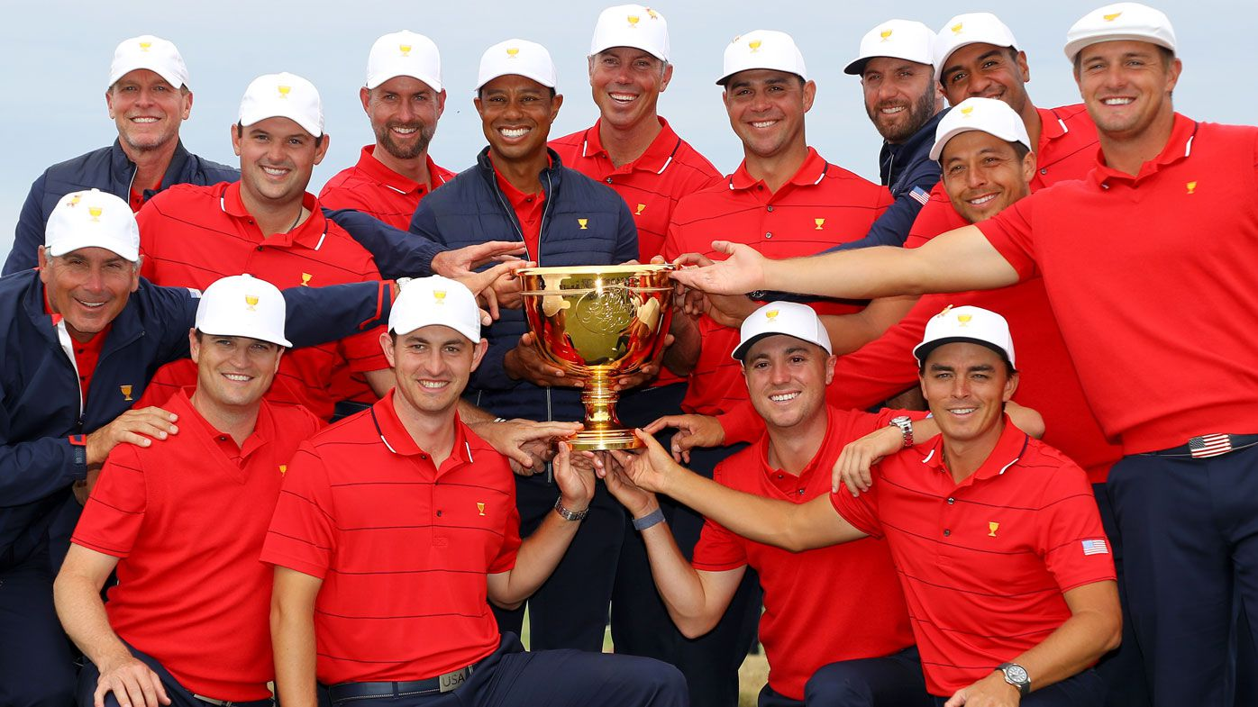 Assistant Captain Steve Stricker, Patrick Reed, Webb Simpson, Playing Captain Tiger Woods, Matt Kuchar, Gary Woodland, Dustin Johnson, Tony Finau, Xander Schauffele, Bryson DeChambeau, (front L-R) Assistant Captain Fred Couples, Assistant Captain Zach Johnson, Patrick Cantlay, Justin Thomas and Rickie Fowler of the United States team celebrate with the cup
