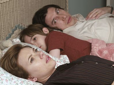 Couple lying in bed Marriage Story Netflix