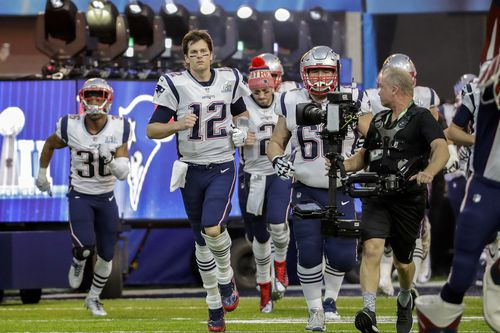 New England Patriots quarterback Tom Brady takes the field. (AAP)