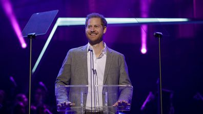 Britain's Prince Harry gives a speech on stage before announcing the winners of the Health and Wellbeing category at the inaugural OnSide Awards at the Royal Albert Hall in London, Sunday, Nov. 17, 2019.