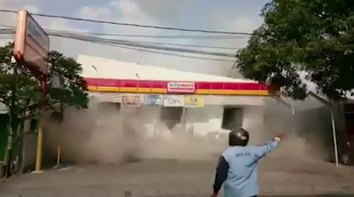 This man was filmed standing within metres of a building as it was pancaked by the aftershock. Picture: Supplied.