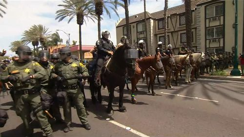 Armed and mounted police were called to the clash. (9NEWS)