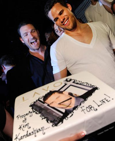 Fiance Kris Humphries wasn't far - he threw his bachelor party on the same night at a different club, celebrating with Kim's brother Robert and Kardashian beaus Scott Disick and Lamar Odom.