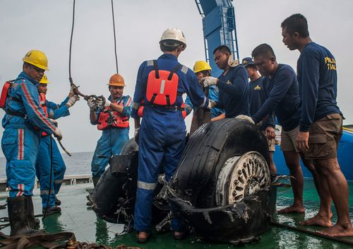 Indonesian rescuers lift recovered wheels of the crashed Lion Air JT-610 on board of a rescue ship in the water off Karawang, West Java, Indonesia, 4 November 2018. Lion Air flight JT-610 lost contact with air traffic controllers soon after takeoff then crashed into the sea on 29 October. The flight was en route to Pangkal Pinang, and reportedly had 189 people onboard.
