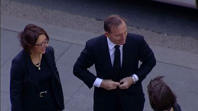Tony Abbott arrives to boos outside Town Hall.