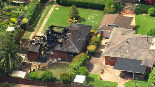The house on fire is next door to a school in Baulkham Hills.
