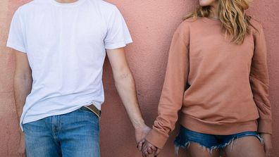 Teenagers holding hands.