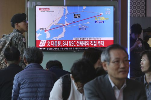People watch a TV screen reporting a North Korea's missile launch, at the Seoul Railway Station in Seoul, South Korea. (AP)