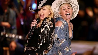 Strike a pose! Madonna said it 25 years ago, and lately Miley Cyrus has really been taking those directions to heart.<br/><br/>In fact, it seems Miley has been striking a lot of Madonna's old poses, which left us wondering: We know they couldn't possibly have been separated at birth, but is Miley, 22, slowly morphing into Madonna, 56?<br/><br/>So we're not quite ready to crown her the next queen of pop. Judging from these photos, though, Miley sure seems keen on being Madonna's heir (and hair) apparent.