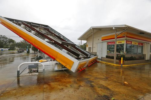 The metal canopy at a petrol station is shown after it was overturned by high winds brought on by Hurricane Irma. (AP)