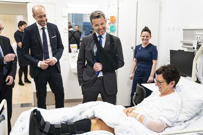 Prince Frederik returns to work with arm in a sling after skiing accident