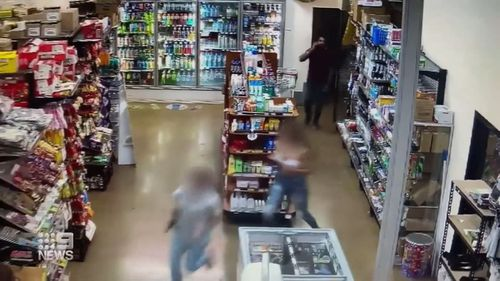 CCTV inside the store shows the teenagers running from the supermarket.