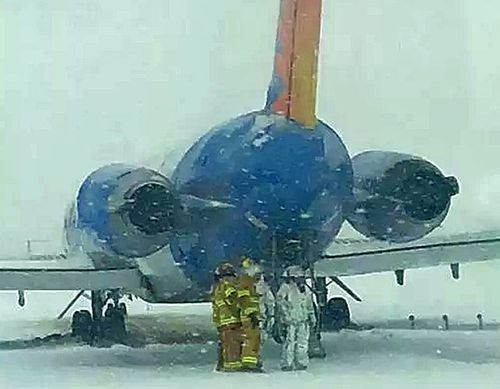 Emergency crews at Sioux Falls Regional Airport inspect the plane after is skidded. (Image: Facebook).