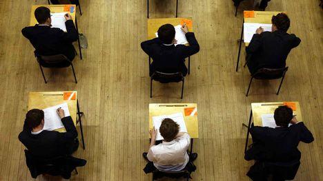 High schoolers sitting an exam. (AAP)