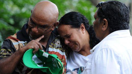 Grieving family members in 2013. (AAP)