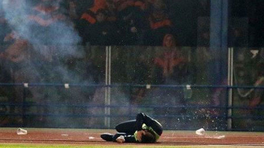 Ball boy injured after fan riot disrupts Cypriot soccer match between APOEL Nicosia and AEL Limassol