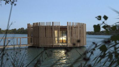 Floating 'treehouse' hotel in France dissolves into the reeds