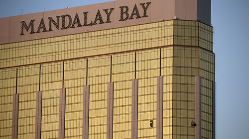 Shattered windows are seen at the Mandalay Bay resort, blown out when Paddock opened fire at the crowd below. (AP)