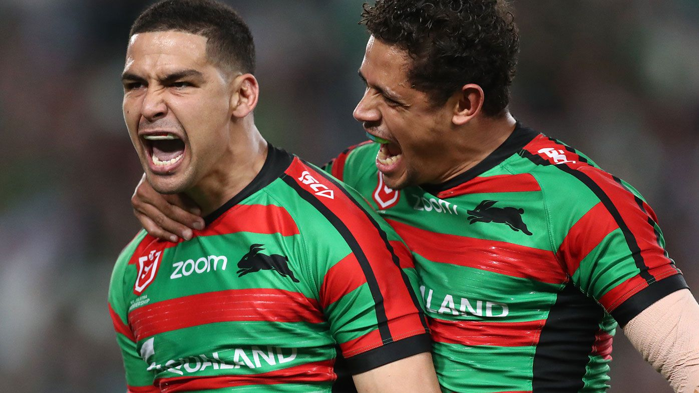 Cody Walker of the Rabbitohs celebrates scoring a try