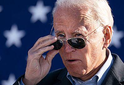 Joe Biden removing sunglasses (Getty)