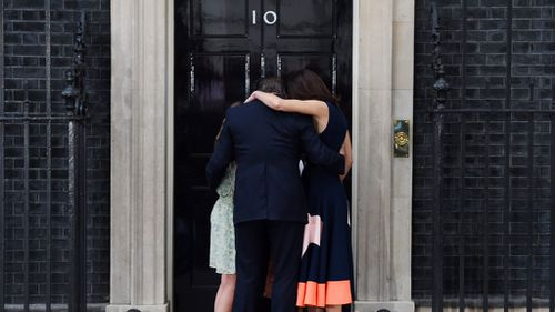David Cameron and his family hug outside 10 Downing Street (AAP)