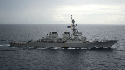 In this photo from October 13, 2016, provided by the U.S. Navy, guided-missile destroyer USS Decatur operates in the South China Sea.