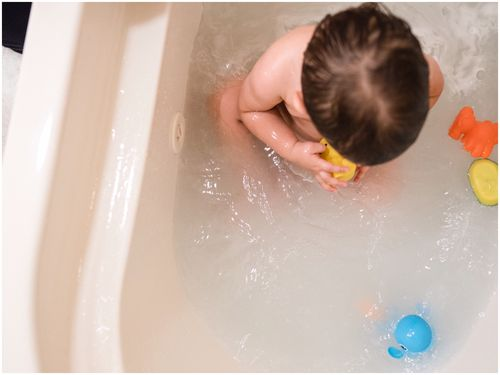 Rosie was left unattended in the bath with her twin brother while her mother was distracted on the phone.
