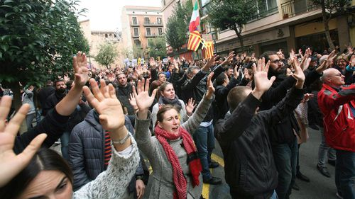 Hundreds of people take part at a demonstration to protest against the imprisonment of pro-independence leaders and demand their freedom in Tarragona, Catalonia. (AAP)