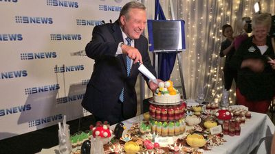 The man of the moment cuts the cake. (9NEWS)