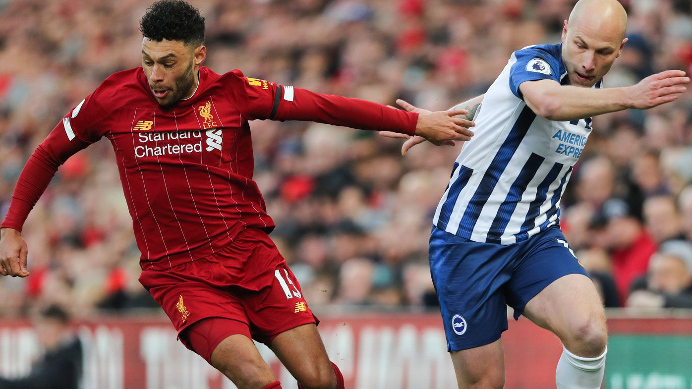 Alex Oxlade-Chamberlain of Liverpool and Aaron Mooy of Brighton and Hove Albion