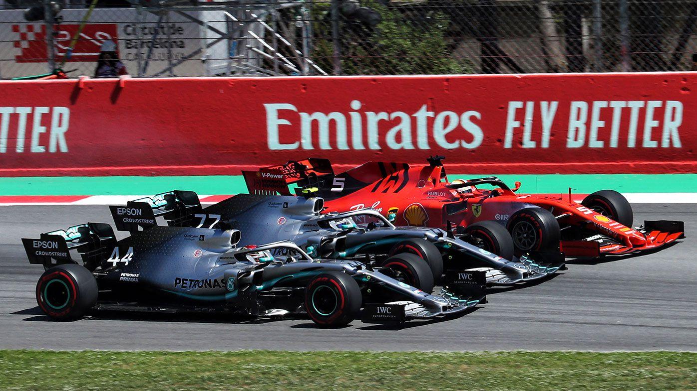 Lewis Hamilton (44), Valtteri Bottas (77) and Sebastian Vettel (5) at the first corner of the Spanish GP.