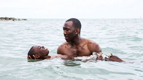 Moonlight was the actual Best Picture winner. Pictured in a still from the film are Alex Hibbert, foreground, and Mahershala Ali. (AAP)