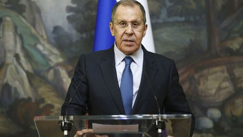 Russian Foreign Minister Sergey Lavrov reads the statement after he leads talks of Armenia and Azerbaijan foreign ministers in Moscow, Russia, early Saturday, October 10, 2020