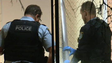 A crime scene has been established at a Marrickville unit block after a woman was stabbed multiple times.
