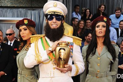 The actor showed up in full dictator regalia, complete with some very controversial bling - a gold urn emblazoned with the image of the late North Korean dictator Kim Jong-il.
